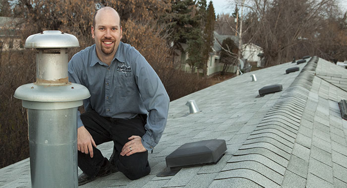 home inspector on a roof in Stettler